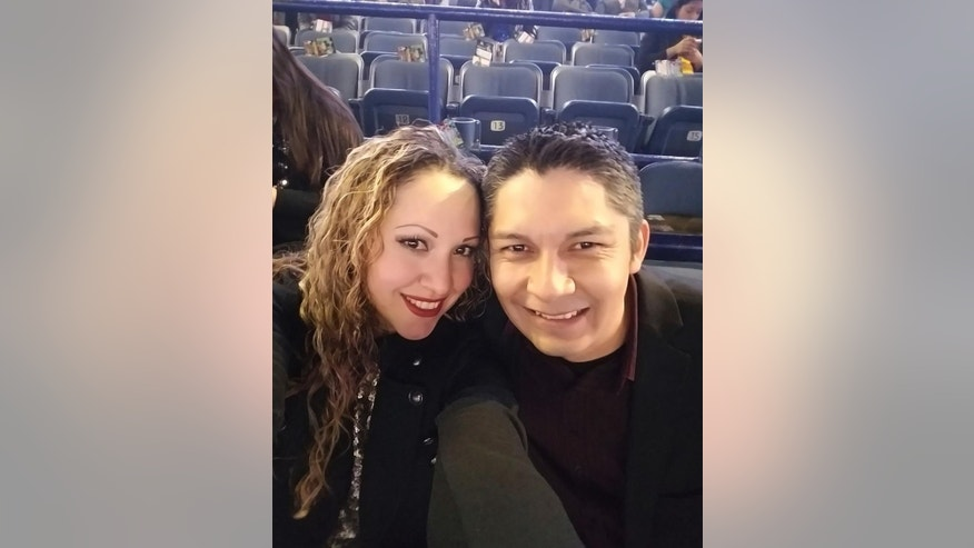 This Dec. 4, 2016 photo provided by Elizabeth Hernandez shows Elizabeth with her husband, Juan Carlos Hernandez Pacheco, at a concert in Chicago. Pacheco, who has been the manager of La Fiesta Mexican Restaurant in West Frankfort, Ill., for a decade was arrested Feb. 9, 2017, by Immigration Customs and Enforcement officials and has been detained at an ICE facility in St. Louis. Pacheco came to the U.S. in the 1990s but didn't obtain legal status.The southern Illinois community that solidly backed President Donald Trump is rallying behind Pacheco, who doesn't have legal permission to live in the U.S. Town residents are writing letters in support, including the mayor and police chief. They deem Hernandez a role model, praising his robust civic involvement. (Elizabeth Hernandez via AP)