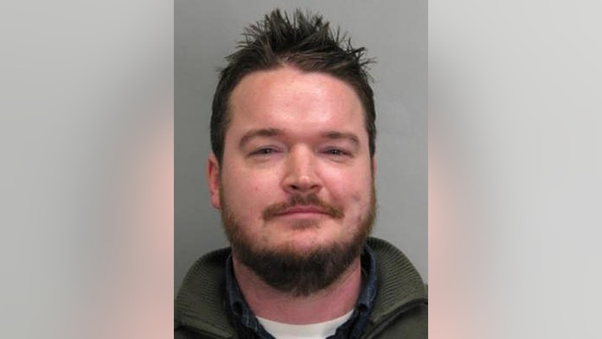 This undated photo provided by the Fairfax County (Va.) Police Department shows Robin McGreer. McGreer, 35, is accused of biting another man's face after making anti-Muslim slurs in a parking lot at a busy shopping mall late last year. Fairfax County police say in a statement McGreer was arrested Monday, Feb. 27, 2017, and charged with bias-related malicious bodily injury. (Fairfax County Police Department via AP)