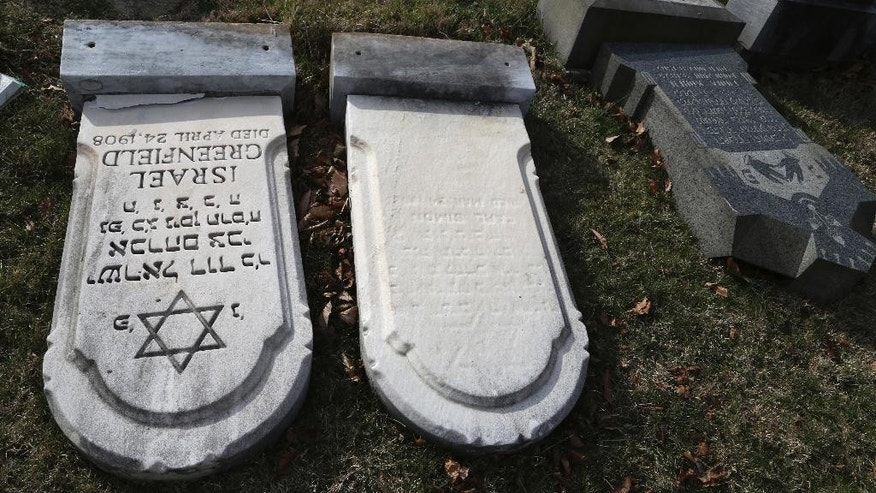 Damaged headstones are seen at Mount Carmel cemetery Monday, Feb. 27, 2017, in Philadelphia. More than 100 headstones have been vandalized at the Jewish cemetery in Philadelphia, damage discovered less than a week after similar vandalism in Missouri, authorities said.(AP Photo/Jacqueline Larma)