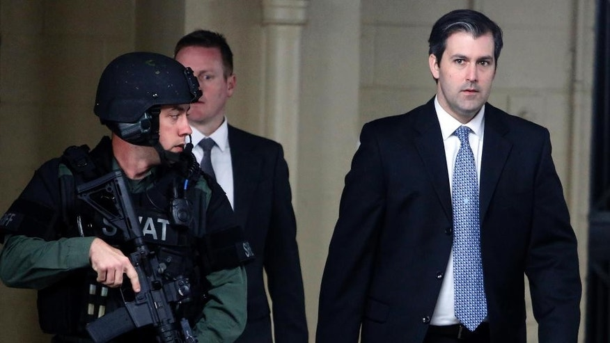 FILE - In this Monday, Dec. 5, 2016, file photo, Michael Slager, right, walks from the Charleston County Courthouse under the protection of the Charleston County Sheriff's Department after a mistrial was declared for his trial in Charleston, S.C. Slager, a former South Carolina police officer charged with killing an unarmed black man running from a traffic stop, says he needs a public defender. (AP Photo/Mic Smith, File)