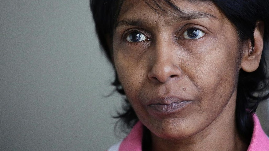 Irene Clennell holds back her tears as she speaks during an interview with The Associated Press Tuesday, Feb. 28, 2017, in Singapore. Clennell, 53, was deported from Britain on Sunday after being sent to an immigration detention center. Clennell had been granted indefinite leave to remain in Britain in 1992, but this lapsed after she stayed outside the country for more than two years. (AP Photo/Wong Maye-E)