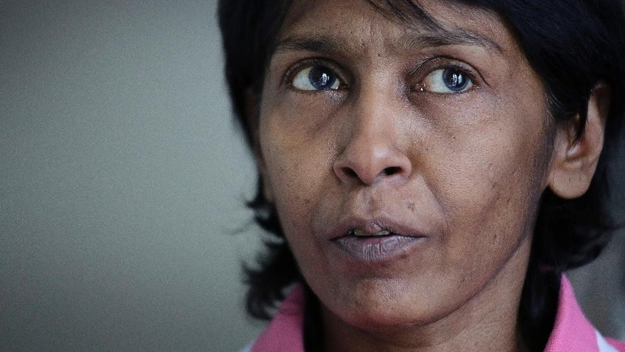 Irene Clennell speaks during an interview with The Associated Press Tuesday, Feb. 28, 2017, in Singapore. Clennell, 53, was deported from Britain on Sunday after being sent to an immigration detention center. Clennell had been granted indefinite leave to remain in Britain in 1992, but this lapsed after she stayed outside the country for more than two years. (AP Photo/Wong Maye-E)