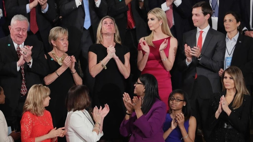 "Carryn Owens, widow of widow of Chief Special Warfare Operator William ""Ryan"" Owens, is applauded on Capitol Hill in Washington, Tuesday, Feb. 28, 2017, as she was acknowledged by President Donald Trump during his address to a joint session of Congress. (AP Photo/J. Scott Applewhite)"