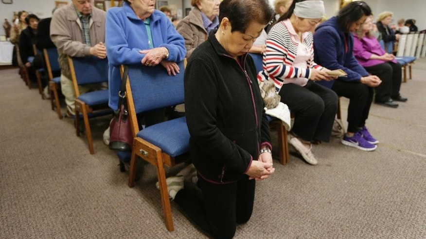 People pray during mass at the Chapel on the Mall on Ash Wednesday, March 1, 2017, in Paramus, N.J. The Roman Catholic chapel at a New Jersey shopping mall is closing after more than 45 years. The chapel, located at the Bergen Town Center, was scheduled to close after an evening mass on Ash Wednesday. (AP Photo/Seth Wenig)