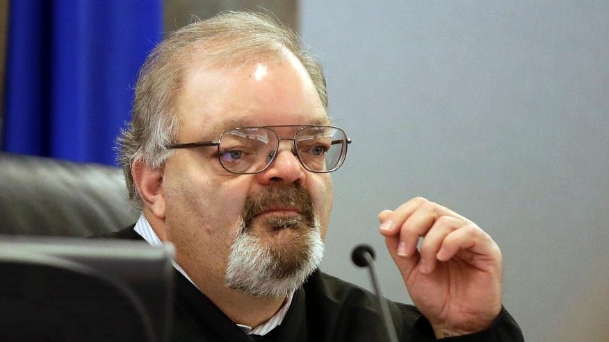 FILE - In this Feb. 23, 2015, file photo, Conrad Hafen presides over a hearing in Las Vegas. The former judge, who lost a re-election bid, has been barred for life from the court bench in Nevada as punishment for ordering a defense attorney handcuffed when she wouldn't stop arguing to keep a client out of jail, and then sentencing her client to jail for petty theft. (AP Photo/Isaac Brekken, File)