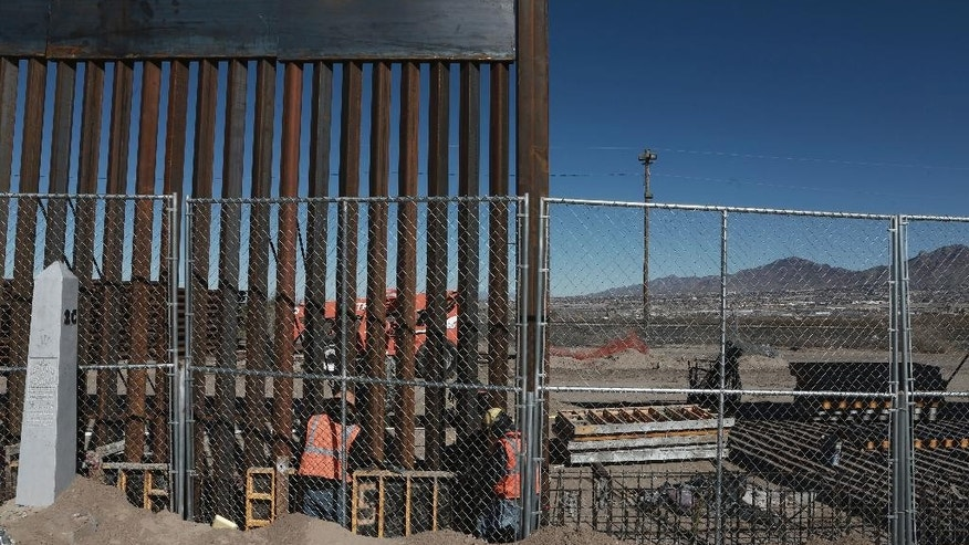 "FILE - In this Jan. 25, 2017 filer photo, work continues on a taller fence in the Mexico-US border area separating the towns of Anapra, Mexico and Sunland Park, New Mexico. President Donald Trump is spotlighting violence committed by immigrants, announcing the creation of a national office that can assist American victims of such crimes. He said during his address Tuesday night that the Homeland Security Department's Victims Of Immigration Crime Engagement office will provide a voice for people ignored by the media and ""silenced by special interests.""  (AP Photo/Christian Torres, File)"