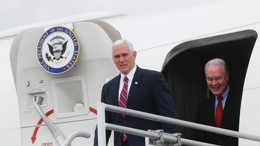 "Vice President Mike Pence, left, and Health and Human Services Secretary Tom Price arrive at Cincinnati/Northern Kentucky International Airport, Thursday, March 2, 2017, in Burlington, Ky. Pence visited Ohio to discuss healthcare and other issues while engaging in a ""listening session"" with small business owners (AP Photo/John Minchillo)"