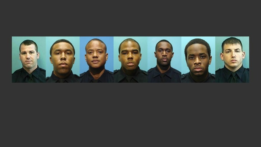RETRANSMITTED FOR IMAGE SIZE - These undated photos provided by the Baltimore Police Department show, from left, Daniel Hersl, Evodio Hendrix, Jemell Rayam, Marcus Taylor, Maurice Ward, Momodu Gando and Wayne Jenkins, the seven police officers who are facing charges of robbery, extortion and overtime fraud, and are accused of stealing money and drugs from victims, some of whom had not committed crimes. (Baltimore Police Department via AP)