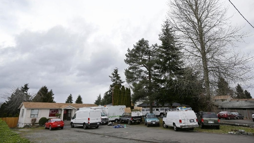"Vehicles are parked Sunday, March 5, 2017, at the home and driveway where a Sikh man was shot in the arm Friday, in Kent, Wash. Authorities said a Sikh man said a gunman shot him in his arm Friday as he worked on his car in his driveway and told him ""go back to your own country."" Sikhs have previously been the target of assaults in the U.S. After the Sept. 11, 2001, attacks, as the backlash that hit Muslims around the country expanded to include those of the Sikh faith. (AP Photo/Ted S. Warren)"