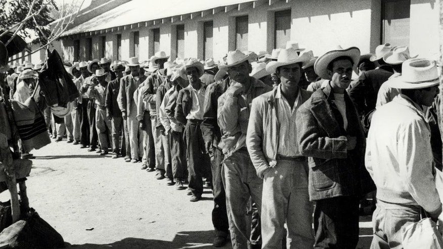 This undated photo provided by the United States Citizenship and Immigration Services' (USCIS) History Library and the National Trust for Historic Preservation, shows workers waiting in line to be contracted at the Rio Vista Farm Reception Center in Sacorro, Texas. During peak times at Rio Vista Farm, up to 1,500 men signed short-term labor contracts to assist with labor shortages across the country. (United States Citizenship and Immigration Services' (USCIS) History Library/National Trust for Historic Preservation via AP)