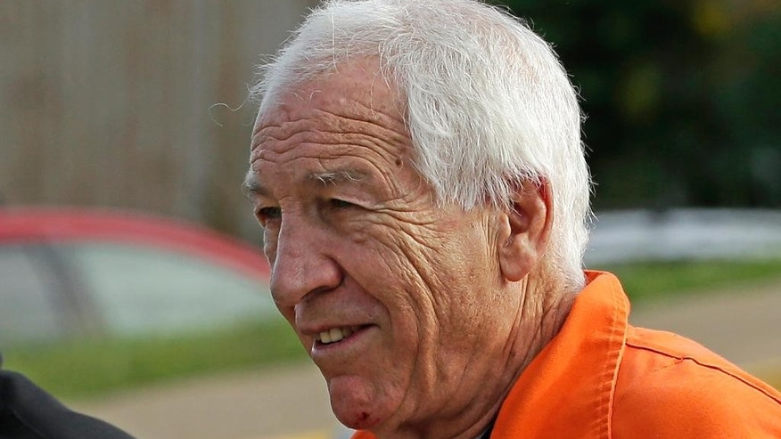 Former Penn State University assistant football coach Jerry Sandusky arrives at the Centre County Courthouse for an appeals hearing.