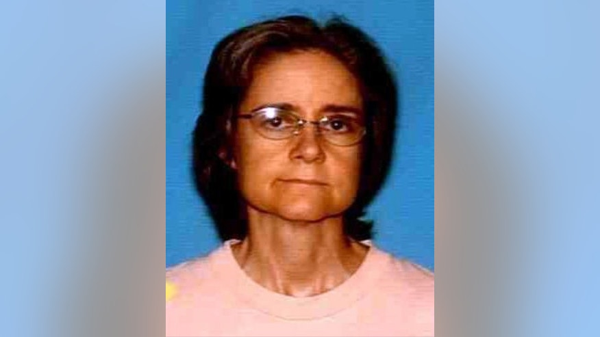 An undated photo provided by the Houston Police Department Missing Persons Unit shows Mary Cerruti. The new owners of a Houston bungalow have discovered human remains in an attic wall that may belong to Cerruti, the previous owner, who went missing at least two years ago. The residents were moving into the home Saturday, March 4, 2017,  when they found a gap in the wall and discovered bones. Cerruti had last been seen in the spring of 2015. (Houston Police Department/Houston Chronicle via AP)