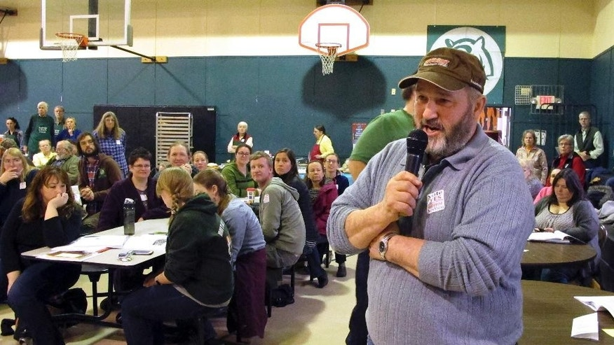 Ted Hoyt talks to fellow residents at the annual Town Meeting Tuesday, March 7, 2017, in Tunbridge, Vt. The town voted overwhelming against a large-scale development by a Utah businessman that would be based on the papers of Mormon leader Joseph Smith. (AP Photo/Lisa Rathke)