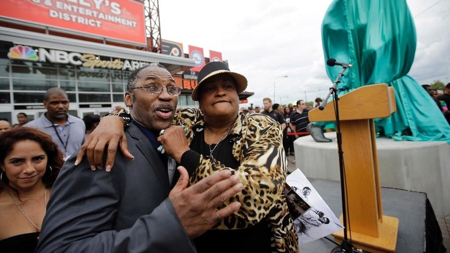FILE - In this Sept. 12, 2015, file photo, Khalilah Ali, right, a former wife of Muhammad Ali, and Marvis Frazier, son of Joe Frazier, pose for a photograph before the unveiling of a statue dedicated to Joe in Philadelphia. Muhammad Ali's son, who bears his name, is launching a campaign in support of religious freedom a month after he and his mother Khalilah were detained by immigration officials at a Florida airport. Ali Jr. said he was questioned about his religion during the incident, which showed him that work remains around his father's fight on the issue. (AP Photo/Matt Slocum, File)