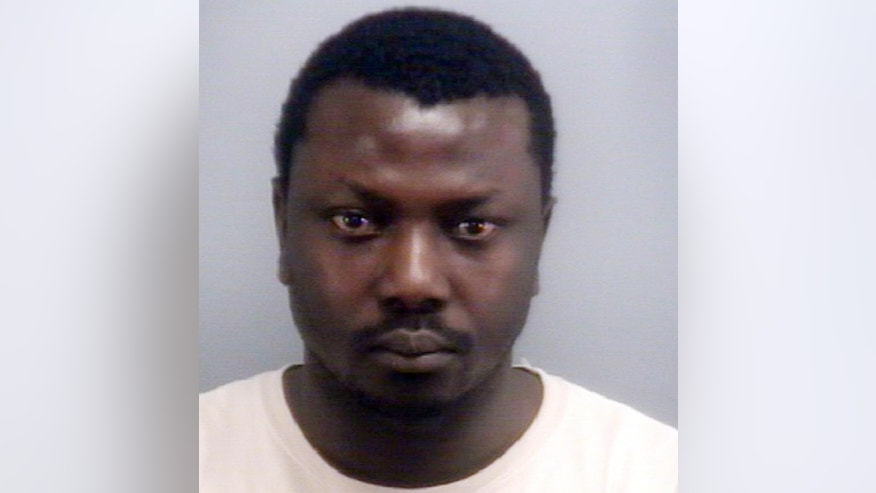 This image provided by the Virginia Beach Police Department shows Sewanou Yoro, an Uber driver who has been arrested for allegedly abducting and sexually assaulting a woman who called for a ride, in Virginia Beach, Va. (Virginia Beach Police Department via AP)