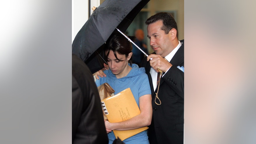 FILE- In this Aug. 21, 2008, file photo, Casey Anthony, mother of missing toddler Caylee, is escorted from the Orange County Florida jail by her attorney Jose Baez. Almost nine years later, Anthony spoke about the death of her daughter and said she does not know how the last hours of Caylee's life unfolded. (AP Photo/Reinhold Matay, File)