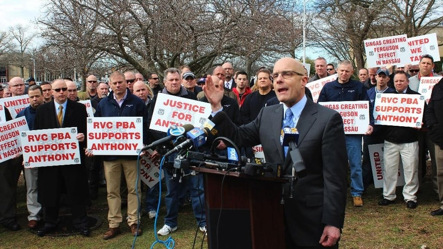Attorney William Petrillo speaks outside the Nassau County Courthouse in Mineola, N.Y., on Wednesday, March 8, 2017. Petrillo represents Anthony Federico, a village of Rockville Centre police officer who pleaded not guilty to felony assault and other charges stemming from a May 2016 incident in which he allegedly struck a suspect with a stun gun and then falsified paperwork about the case. (AP Photo/Frank Eltman)