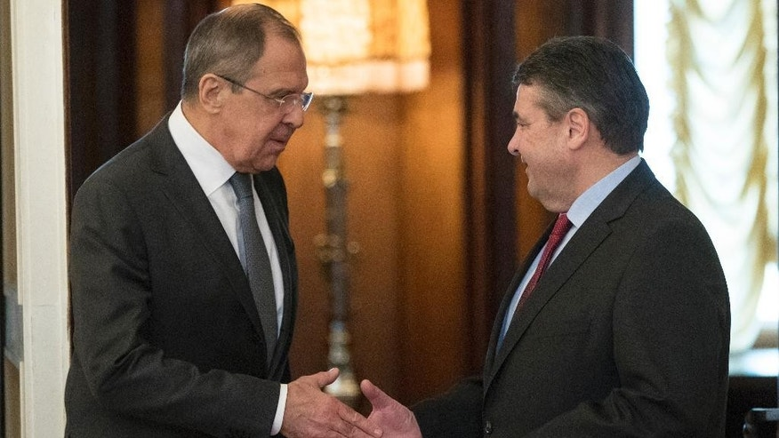 Russian Foreign Minister Sergey Lavrov, left, shakes hands with German counterpart Sigmar Gabriel in Moscow, Russia on Thursday, March 9, 2017. (AP Photo/Pavel Golovkin)