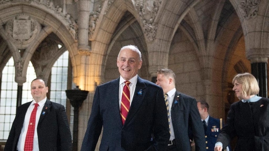 U.S. Secretary of Homeland Security John Kelly, centre, walks through the Rotunda in Centre Block as he leaves Parliament Hill after a day of bilateral meetings with multiple Canadian ministers on Friday, March 10, 2017 in Ottawa. (Justin Tang/The Canadian Press via AP)