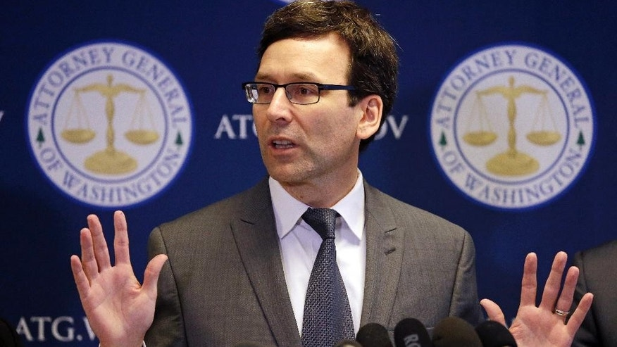 Washington State Attorney General Bob Ferguson speaks at a news conference about the state's response to President Trump's revised travel ban Thursday, March 9, 2017, in Seattle. Legal challenges against Trump's revised travel ban mounted Thursday as Washington state said it would renew its request to block the executive order. It came a day after Hawaii launched its own lawsuit, and Ferguson said both Oregon and New York had asked to join his state's legal action. (AP Photo/Elaine Thompson)