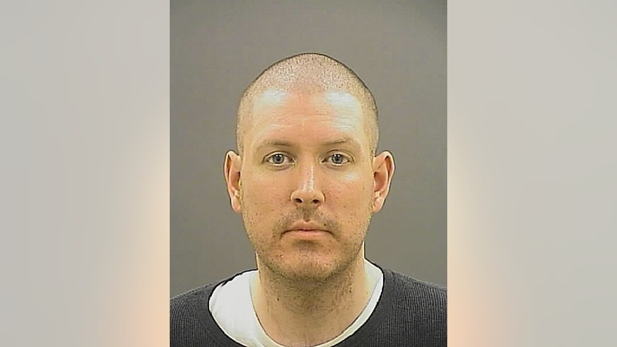This photo provided by the Baltimore Police, Erich Justin Kuhn is shown. Police said Friday, March 10, 2017,  that officers responding to a report of a suspicious death Wednesday found 63-year-old Cathy Kuhn unresponsive. Since there were no visual signs of trauma, police say the medical examiner's office declined to investigate. Kuhn's body was released to her family and a funeral home, where police say staff discovered possible signs of trauma to her neck and head. Detectives responded and police say their investigation revealed that Kuhn's son, 32-year-old Erich Kuhn, strangled his mother at her home. He was arrested Thursday. (Baltimore Police via AP)