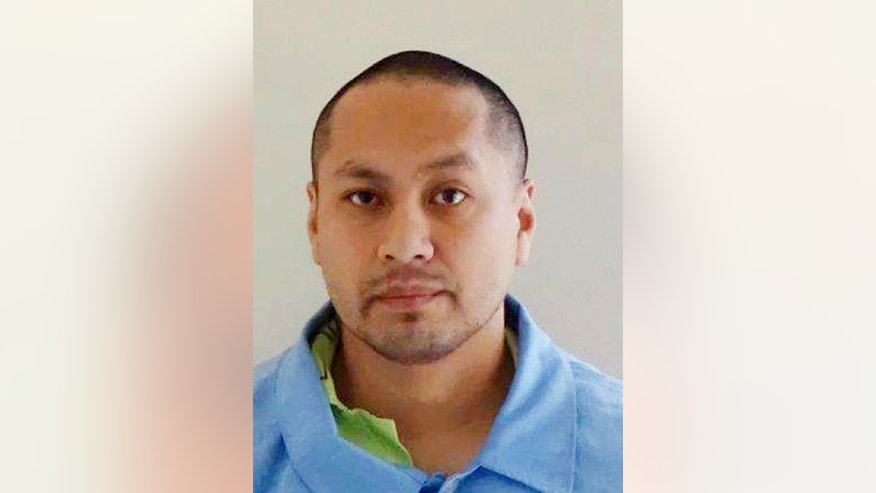 FILE - This undated file photo provided by the Iowa Department of Corrections shows inmate Lha Southideth-Whiten, who a prison judge found was responsible for the beating of fellow inmate Michael Whitworth, who died Oct. 30, 2016, at the Iowa State Penitentiary in Fort Madison. Southideth-Whiten has been charged with second-degree murder in the October beating death of Whitworth. (Iowa Department of Corrections via AP File)