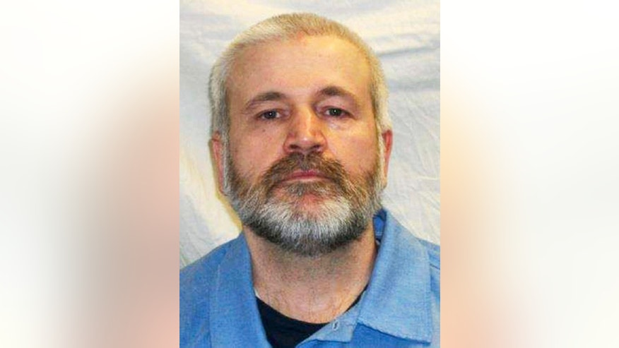 FILE - This undated file photo provided by the Iowa Department of Corrections shows inmate Michael Whitworth, who died Oct. 30, 2016, after suffering a beating by a fellow prisoner at the Iowa State Penitentiary in Fort Madison. Lha Southideth-Whiten has been charged with second-degree murder in the October beating death of Whitworth. (Iowa Department of Corrections via AP File)