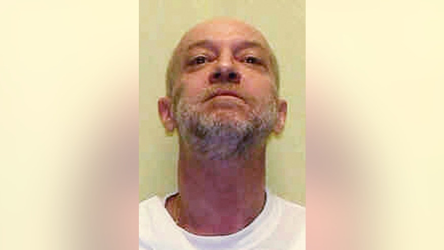 FILE – This undated file photo provided by the Ohio Department of Rehabilitation and Correction shows death row inmate Raymond Tibbetts, scheduled for execution on July 26, 2017, for fatally stabbing Fred Hicks in 1997 in Cincinnati. Ohio Parole Board members denied mercy for Tibbetts, voting 11-1 against clemency in a decision released Friday, March 10, 2017. Republican Ohio Gov. John Kasich has final say. Tibbetts is also sentenced to life imprisonment without parole for the beating death of his wife Judith Crawford. (Ohio Department of Rehabilitation and Correction via AP, File)