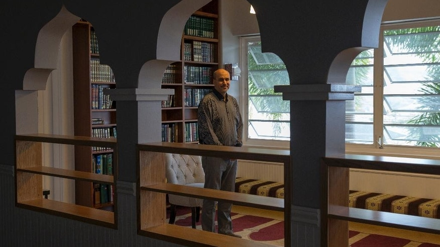 Framed by Islamic-style arches, Muslim Association of Hawaii President Hakim Ouansafi stands inside the library room of the group's building, Thursday, March 9, 2107, in Honolulu. The mosque has been serving Hawaii for nearly 50 years, according to the association. (AP Photo/Marco Garcia)