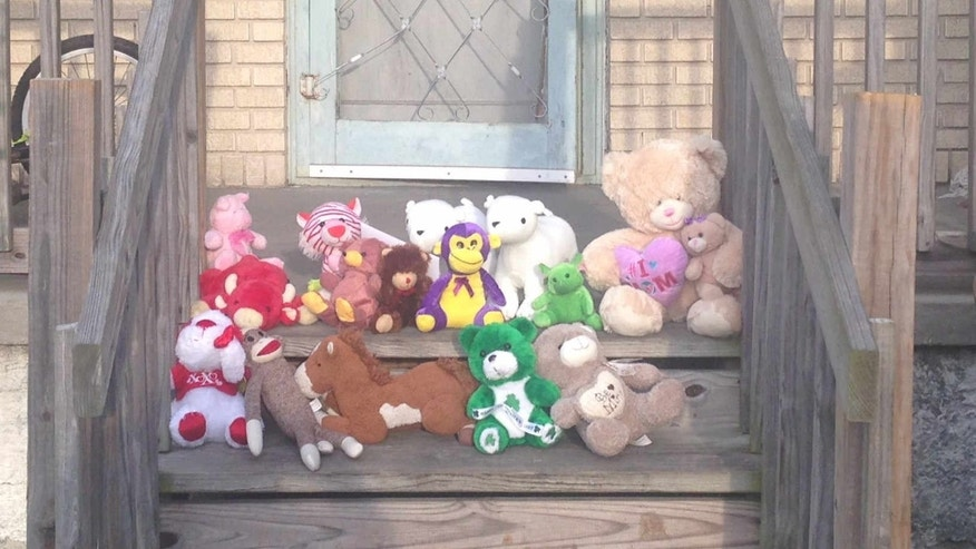 Mourners have turned the site of a quadruple shooting in New Orleans into a makeshift shrine.