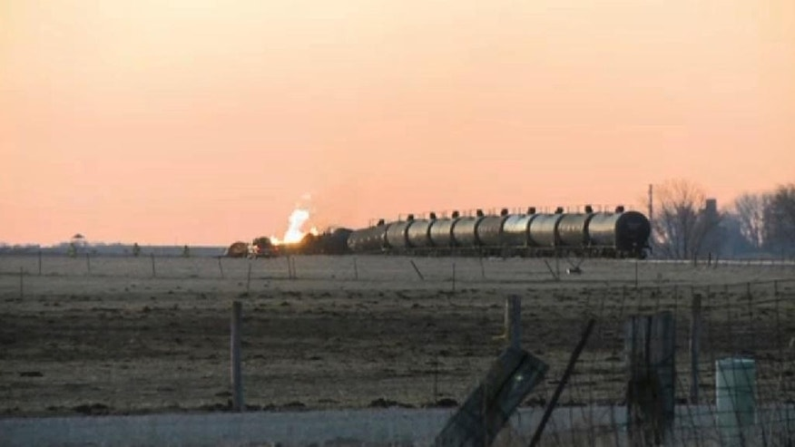 In this photo made from a video shot and provided by KTIV, several tank cars burn after a freight train, carrying ethanol, derailed around 1 a.m., Friday, March 10, 2017, near the small community of Graettinger in northwestern Iowa. Environmental experts were checking for ethanol leaks after the freight train derailed and burst into flames as it crossed a trestle bridge over a creek that empties into the Des Moines River. (Courtesy of KTIV via AP)