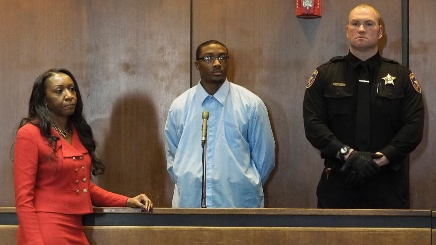 Defense attorney Shevelle McPherson, left, stands next to her client, Khalil Wheeler-Weaver, 20, of Orange, center, as Wheeler-Weaver appears in Superior Court in Newark to be arraigned for the murder of Robin West, 19 of Philadelphia. Wheeler-Weaver previously pleaded not guilty to the strangling deaths of Joanne Browne, 33, and Sarah Butler, 20. March 13, 2017 (Patti Sapone/NJ Advance Media via AP, Pool)