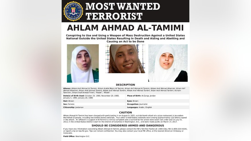 This image provided by the FBI is the most wanted poster for Ahlam Aref Ahmad Al-Tamimi, a Jordanian woman charged in connection with a 2001 bombing of a Jerusalem pizza restaurant that killed 15 people and injured dozens of others. The case against Ahlam Aref Ahmad Al-Tamimi was filed under seal in 2013 but announced publicly by the Justice Department on March 14, 2017. The FBI has added Al-Tamimi, who served eight years in prison after pleading guilty in an Israeli court, to its list of Most Wanted Terrorists. (FBI via AP)