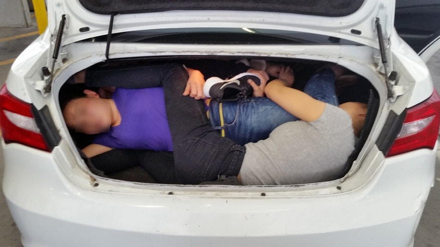 US customs officers discovered four Chinese citizens crammed into the trunk of a car at the US/Mexico border.