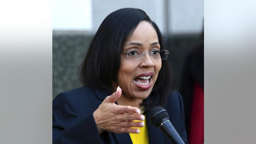 In a press conference on the steps of the Orange County Courthouse, Florida Orange-Osceola State Attorney Aramis Ayala announces Thursday, March 16, 2017, that her office will no longer pursue the death penalty as a sentence in any case brought before the 9th Judicial Circuit of Florida. (Joe Burbank/Orlando Sentinel via AP)/Orlando Sentinel via AP)