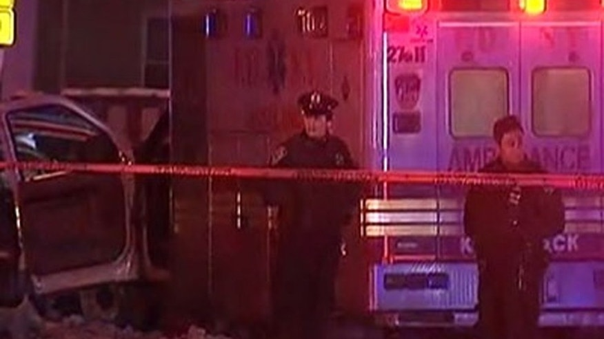 This still image taken from video shows police at the scene where Yadira Arroyo, 44, an emergency medical technician has died after she was run over by a stolen ambulance, Thursday, March 16, 2017, in the Bronx borough of New York.  (WNYW FOX 5 NY via AP)