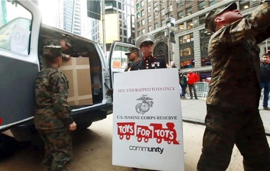 "This undated still image from a TV advertisement provided by the U.S. Marine Corps, is part of a new recruitment ad campaign by the Corps, meant to draw millennials by showing Marines as not only strong warriors but good citizens. ""Battles Won"" is the name of the campaign that includes TV ads and online clips of Marines unloading ""Toys for Tots"" boxes and real video of a Marine veteran tackling an armed robber. The military's smallest branch is also considering replacing its iconic slogan, ""The Few. The Proud. The Marines."" (U.S. Marine Corps via AP)"