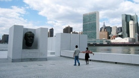 FILE - This May 1, 2014, file photo, shows visitors taking pictures in front of a bust of President Franklin D. Roosevelt at Franklin D. Roosevelt Four Freedoms Park, located on Roosevelt Island in New York. Roosevelt Island will be getting its only hotel, the Graduate Roosevelt Island, in 2019. The Graduate hotel will be located on the gateway of the island's new Cornell Tech campus and will offer skyline views. (AP Photo/Beth J. Harpaz, File)
