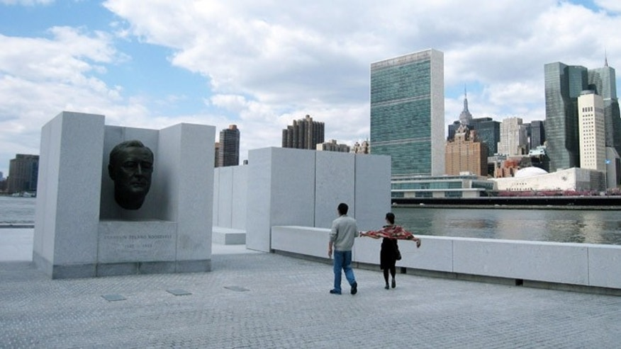 Visitors snap photos at Franklin D. Roosevelt Four Freedoms Park in New York City.