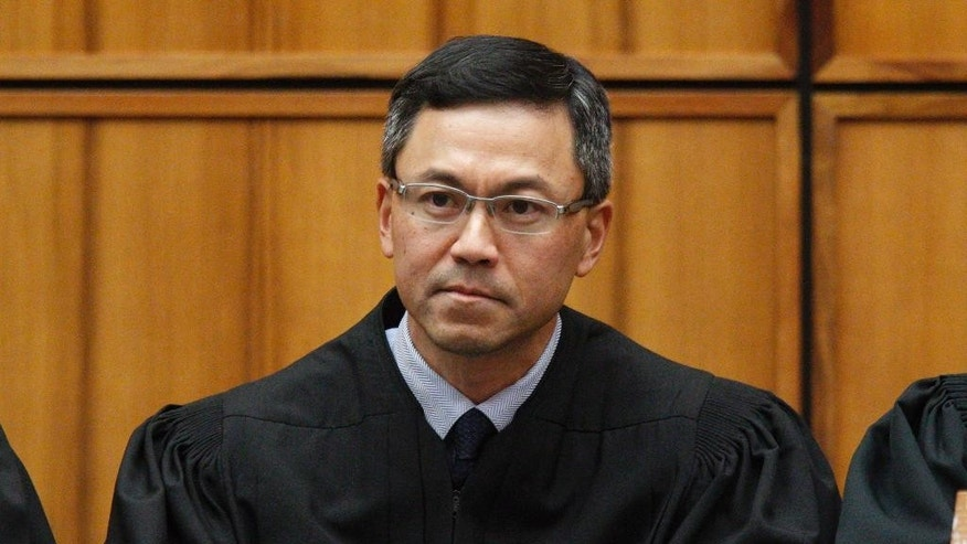 This December 2015 photo shows U.S. District Judge Derrick Watson in Honolulu. Hours before it was to take effect, President Donald Trump's revised travel ban was put on hold Wednesday, March 15, 2017, by Watson, a federal judge in Hawaii who questioned whether the administration was motivated by national security concerns. (George Lee/The Star-Advertiser via AP)
