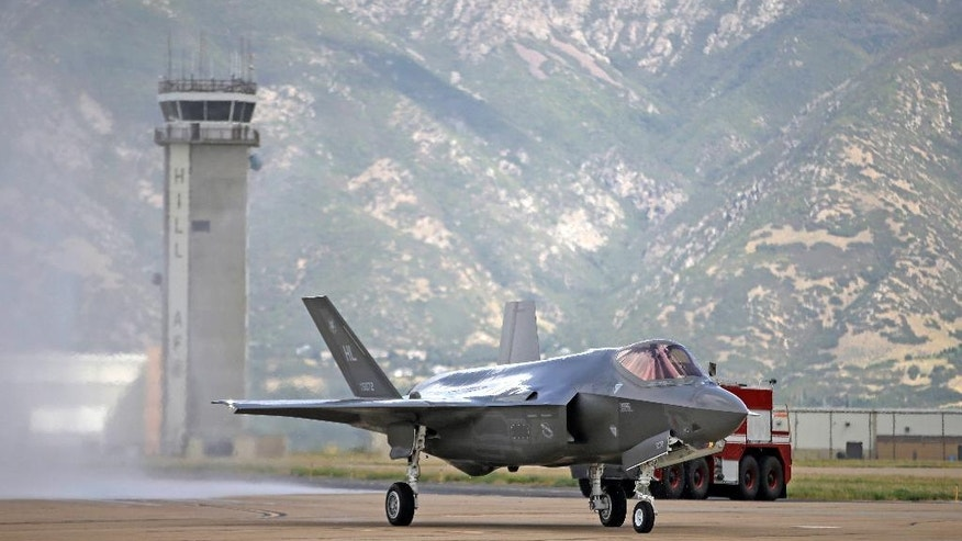 FILE - This Sept. 2, 2015, file photo shows an F-35 jet arriving at its new operational base at Hill Air Force Base in Utah. The U.S. and its Asia-Pacific allies are rolling out their new stealth fighter jet, a cutting-edge plane that costs about $100 million each. (AP Photo/Rick Bowmer, File)