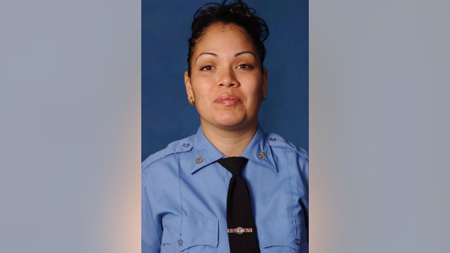 This undated photo provided by the Fire Department of New York shows FDNY emergency medical technician Yadira Arroyo. Police said the EMT in New York City died after she was run over Thursday, March 16, 2017, by her own ambulance that had just been stolen. (Fire Department of New York via AP)