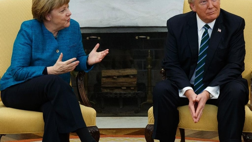 President Donald Trump meets with German Chancellor Angela Merkel in the Oval Office of the White House in Washington, Friday, March 17, 2017. (AP Photo/Evan Vucci)