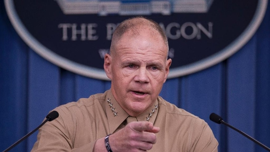 FILE - In this March 10, 2017 file photo, Marine Corps Commandant Gen. Robert Neller speaks during a news conference at the Pentagon. Battered by a nude photo scandal, the Marine Corps has published a longer and more detailed social media policy, laying out the professional and legal ramifications for service members who participate in online misconduct.  (AP Photo/Cliff Owen, File)