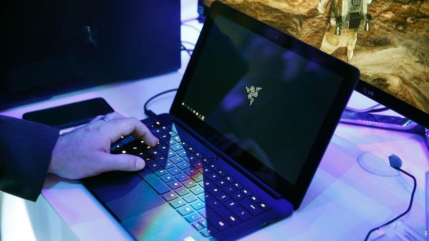 FILE - In this Jan. 7, 2016 file photo, a laptop is seen in Las Vegas. Royal Jordanian Airlines is advising passengers that laptops, iPads, cameras and other electronics won't be allowed in carry-on luggage for U.S.-bound flights starting Tuesday, March 21, 2017.  (AP Photo/John Locher, File)