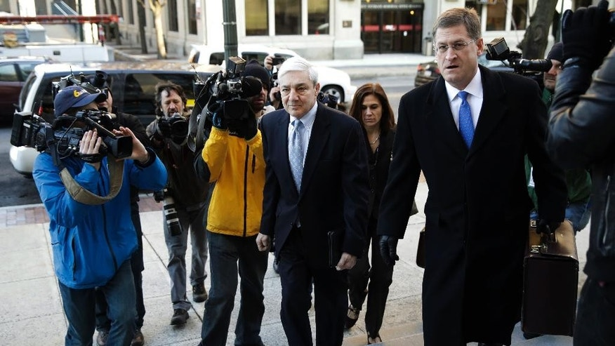 Former Penn State president Graham Spanier walks to the Dauphin County Courthouse in Harrisburg, Pa., Monday, March 20, 2017. Jury selection begins on Monday in Spanier's trial on charges that children were put at risk by how he responded to child sex abuse complaints about Jerry Sandusky more than 15 years ago. (AP Photo/Matt Rourke)