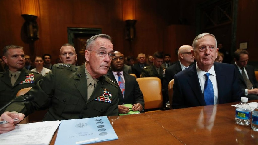 Defense Secretary Jim Mattis, right, and Joint Chiefs Chairman Gen. Joseph Dunford, prepare to testify on Capitol Hill in Washington, Wednesday, March 22, 2017, before the Senate Appropriations subcommittee hearing on the Defense Department's fiscal 2018 budget. (AP Photo/Manuel Balce Ceneta)