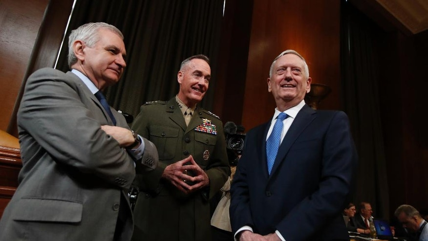 From left, Senate Appropriations subcommittee member Sen. Jack Reed, D-R.I., Joint Chiefs Chairman Gen. Joseph Dunford and Defense Secretary Jim Mattis confer on Capitol Hill in Washington, Wednesday, March 22, 2017, prior to the start of the committee's hearing on the Defense Department's fiscal 2018 budget.  (AP Photo/Manuel Balce Ceneta)