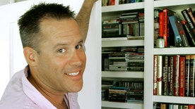 """FILE - This Sept. 2, 2005 file photo shows best-selling author Vince Flynn in the library of his Edina, Minn. home.  The late Minnesota author's counterterrorism operative Mitch Rapp is coming to the big screen in September. CBS Films and Lionsgate announced Wednesday, March 22, 2017 that """"American Assassin,"""" based in Flynn's best-seller, will hit theaters nationwide and in North America on Sept. 15. Flynn wrote a series of thrillers featuring Rapp. He died in 2013 after battling prostate cancer.  (AP Photo/Jim Mone)"""