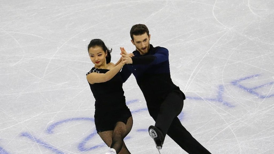 In this Feb. 16, 2017, photo, Yura Min and Alexander Gamelin perform in the Ice Dance Short Dance program at the ISU Four Continents Figure Skating Championships in Gangneung, South Korea.  Gamelin, an ice dancer from Boston, has the anthem memorized and is brushing up on Korean culture and history ahead of his immigration interview. The aim is to become a naturalized citizen, then a South Korean Olympian.  His dance partner is Yura Min is a California-born South Korean citizen.  (AP Photo/Ahn Young-joon)